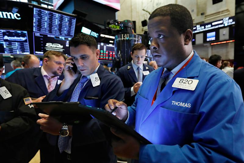 Thomas Lee, right, works with fellow traders on the floor of the New York Stock Exchange, Thursday, May 23, 2019. Stocks are falling at the open on Wall Street as investors worry about an apparent stalemate in trade talks between the U.S. and China. (AP Photo/Richard Drew)