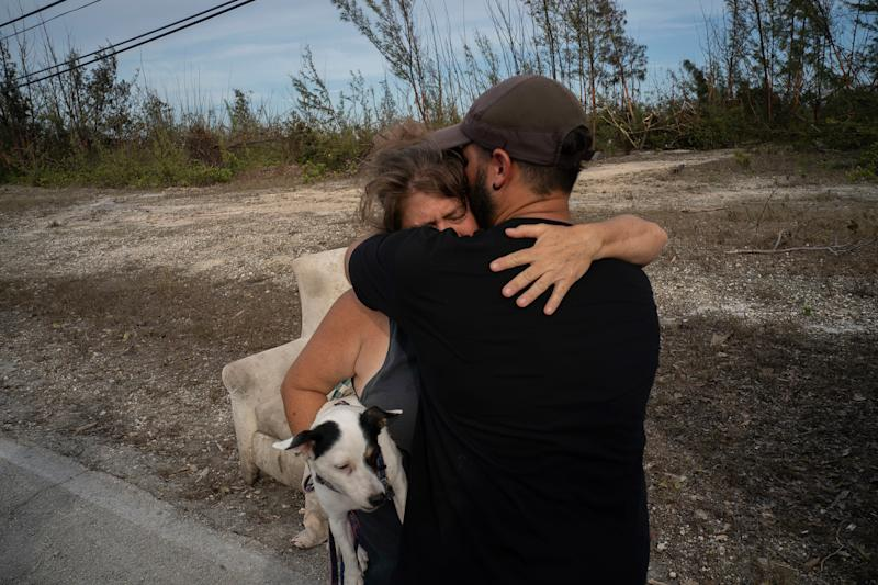 Sissel Mosvold embraces a volunteer who helped rescue her mother from her home when it was flooded by the waters of Hurricane Dorian, in the outskirts of Freeport, Bahamas, Sept. 4, 2019. | Ramon Espinosa—AP