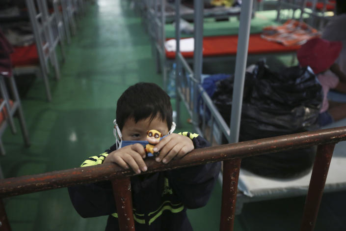 A child plays in the Kiki Romero Sports Complex migrant shleter after he was deported from the U.S., in Ciudad Juarez, Mexico, Wednesday, April 21, 2021. Mexico said it is planning to set up 17 shelters for underage migrants along the country's southern border, as well as some along the northern border with the United States, amid a wave of child migrants coming from Central America. (AP Photo/Christian Chavez)