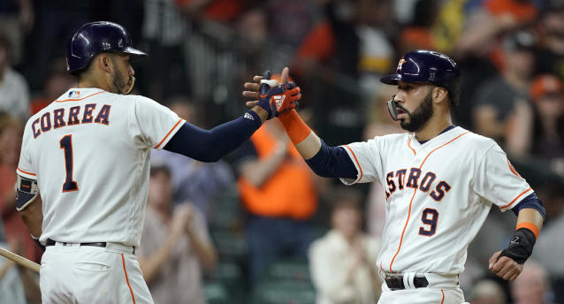 Houston Astros' Marwin Gonzalez (9) celebrates with Carlos Correa (1) after hitting a two-run home run against the Seattle Mariners during the third inning of a baseball game Tuesday, Sept. 18, 2018, in Houston. (AP Photo/David J. Phillip)