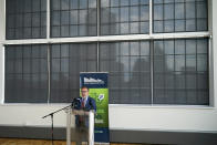 The Pittsburgh skyline is silhouetted in the shades of windows at the Energy Innovation Center as Andrew Wheeler, the EPA Administrator, speaks about the rollback of the 2016 methane emissions rules to undo Obama-era rules designed to limit greenhouse gas emissions from oil and gas fields and pipelines,Thursday, Aug. 13, 2020, in Pittsburgh. (AP Photo/Keith Srakocic)