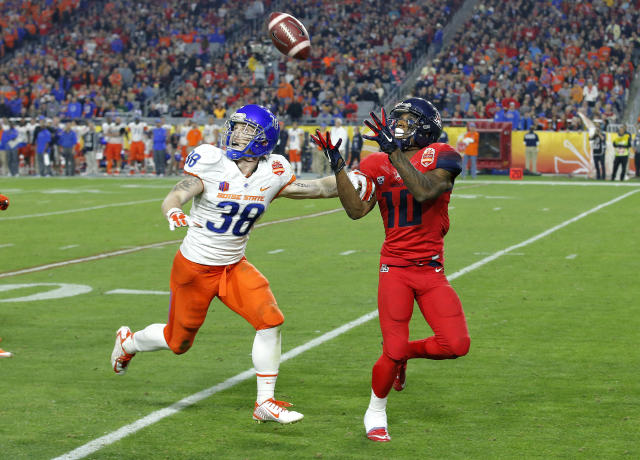 Arizona running back Samajie Grant (10) pulls in a touchdown pass as Boise State's Corey Bell (38) defends during the second half of the Fiesta Bowl NCAA college football game, Wednesday, Dec. 31, 2014, in Glendale, Ariz. (AP Photo/Ross D. Franklin)