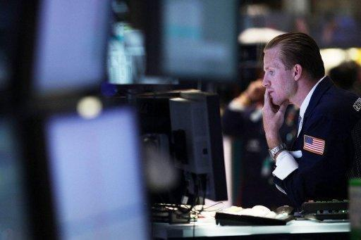 US stocks recover steep losses, end slightly lower