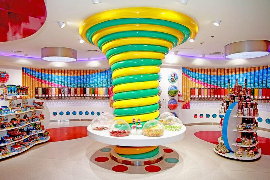 """<em>Panorama Mall, Takhassusi Street, Riyadh, Saudi Arabia</em><br> <em><a rel=""""nofollow"""" href=""""http://candylawa.com/"""">candylawa.com</a></em><br> Pronounced """"candy lover,"""" Candylawa is a cartoonlike wonderland of sweets. Created by Redesign Group, a New Zealand firm, the two-level store is divided into several sections, including stations for design-your-own lollipops or marshmallows and a French patisserie for parents—or kids—with a more sophisticated palate."""