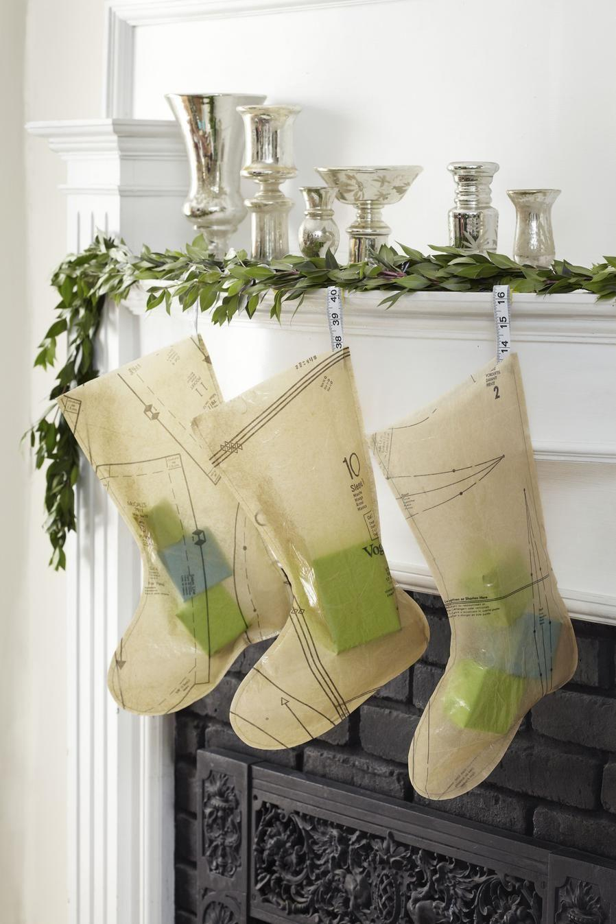"""<p>Use iron-on vinyl to turn paper patterns into durable fabric for stockings. </p><p><strong><a href=""""https://www.countryliving.com/diy-crafts/how-to/g1071/unique-christmas-stocking-craft-1210/"""" rel=""""nofollow noopener"""" target=""""_blank"""" data-ylk=""""slk:Get the tutorial."""" class=""""link rapid-noclick-resp"""">Get the tutorial.</a></strong> </p><p><a class=""""link rapid-noclick-resp"""" href=""""https://www.amazon.com/s/ref=nb_sb_noss_1?url=search-alias%3Daps&field-keywords=iron-on+vinyl+&rh=i%3Aaps%2Ck%3Airon-on+vinyl+&tag=syn-yahoo-20&ascsubtag=%5Bartid%7C10050.g.1407%5Bsrc%7Cyahoo-us"""" rel=""""nofollow noopener"""" target=""""_blank"""" data-ylk=""""slk:SHOP IRON-ON VINYL"""">SHOP IRON-ON VINYL</a></p>"""