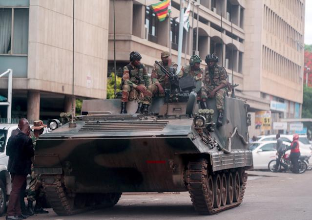 <p>A group of soldiers seal off a main road to the parliament building within the military activities taking place in Harare, Zimbabwe on Nov. 16, 2017. (Photo: Tafadzwa Ufumeli/Anadolu Agency/Getty Images) </p>