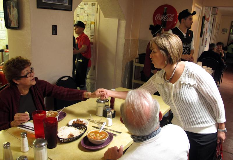 In this Oct. 19, 2012 photo, Michelle Lujan Grisham, a Democrat who became New Mexico's first Latina elected to Congress after winning the state's open 1st Congressional District race on Tuesday, Nov. 6, 2012, is shown speaking with Hispanic voters at Barelas Coffee House in Albuquerque, N.M. Among many troubling signs for Republicans Tuesday night was the continued drift of Hispanics _ the nation's fastest-growing ethnic group _ into the blue column. Republican Mitt Romney backed hardline immigration measures during the primary and won only 27 percent of the Hispanic vote Tuesday, less than any presidential candidate in 16 years. (AP Photo/Russell Contreras)