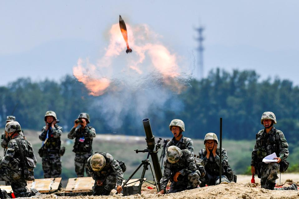 Soldiers of the Chinese People's Liberation Army fire a mortar during a live-fire military exercise last month (Reuters)