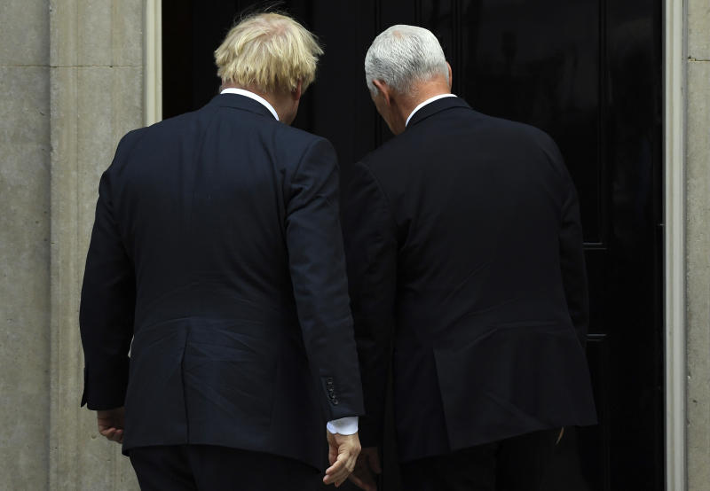 Britain's Prime Minister Boris Johnson, left, greets US Vice President Mike Pence on the doorstep of 10 Downing Street, in London, Thursday, Sept. 5, 2019.(AP Photo/Alberto Pezzali)