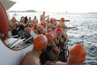 Swimmers with the Dolphin Club wait for the signal to jump into San Francisco Bay near Alcatraz Island during the annual New Year's Day swim to Aquatic Park in San Francisco, California January 1, 2015. REUTERS/Stephen Lam (UNITED STATES - Tags: ANNIVERSARY SOCIETY)