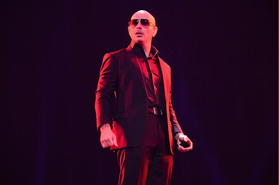 """<p>Pit, who was born in Miami to Cuban parents, has had 10 top 10 hits. The tally includes two No. 1s: """"Give Me Everything,"""" which featured Ne-Yo, AfroJack and Nayer, and """"Timber,"""" which featured Kesha. Pit's top 10 tally also includes featured credits on hits by Enrique Iglesias, Usher and J.Lo. (Photo: Michael Loccisano/Getty Images for Plent)<br></p>"""