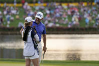 Lee Westwood, of England, talks with his caddie Helen Storey on the 16th green during the third round of The Players Championship golf tournament Saturday, March 13, 2021, in Ponte Vedra Beach, Fla. (AP Photo/Gerald Herbert)