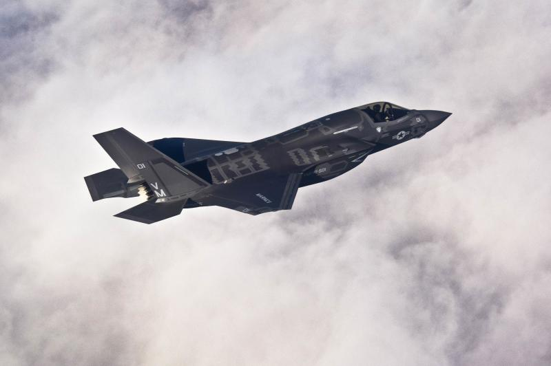 A Lockheed Martin F-35B Lightning II joint strike fighter flies toward its new home at Eglin Air Force Base, Florida in this U.S. Air Force picture taken on January 11, 2011.  Lockheed Martin Corp on Monday said it has delivered the next version of the computer-based logistics system used to support the F-35 fighter jet to the U.S. military for flight testing.  REUTERS/U.S. Air Force/Staff Sgt. Joely Santiago/Handout  (UNITED STATES - Tags: MILITARY TRANSPORT BUSINESS)  THIS IMAGE HAS BEEN SUPPLIED BY A THIRD PARTY. IT IS DISTRIBUTED, EXACTLY AS RECEIVED BY REUTERS, AS A SERVICE TO CLIENTS. FOR EDITORIAL USE ONLY. NOT FOR SALE FOR MARKETING OR ADVERTISING CAMPAIGNS
