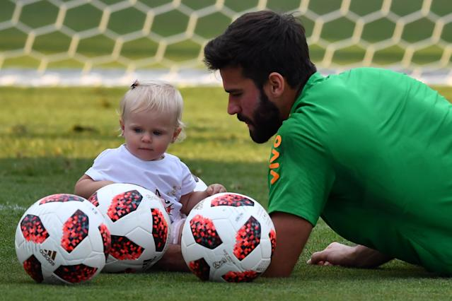 <p>Brazil's goalkeeper Alisson is seen with his daughter Helena during a training session at the Yug Sport Stadium in Sochi, on July 3, 2018, ahead of the Russia 2018 World Cup quarter-final football match between Brazil and Belgium on July 6. (Photo by NELSON ALMEIDA / AFP) </p>