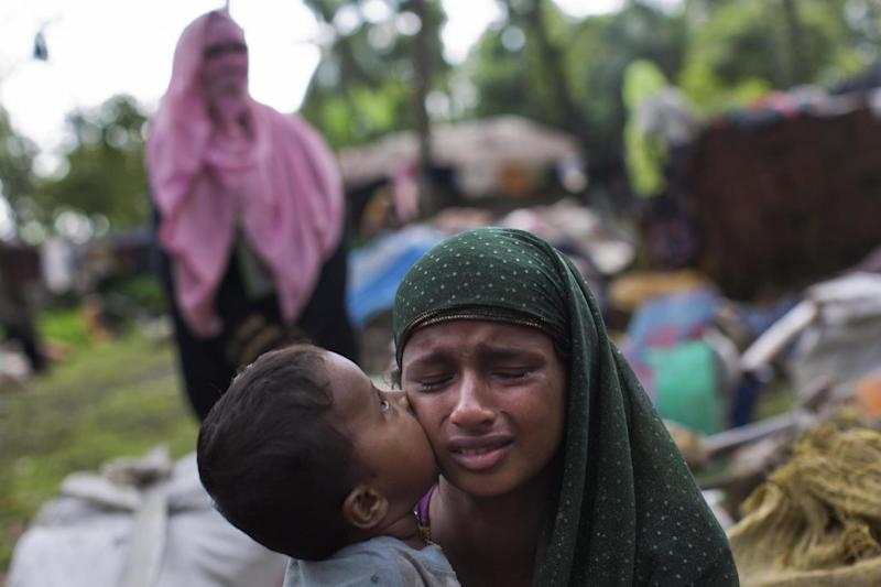 Violence: Rohingya child kisses his mother after they fled from conflict-ridden Burma (AP)