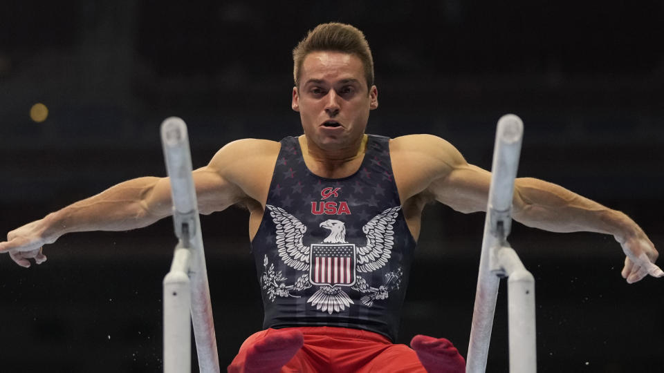 Sam Mikulak competes on the parallel bars during the men's U.S. Olympic Gymnastics Trials Saturday, June 26, 2021, in St. Louis. (AP Photo/Jeff Roberson)
