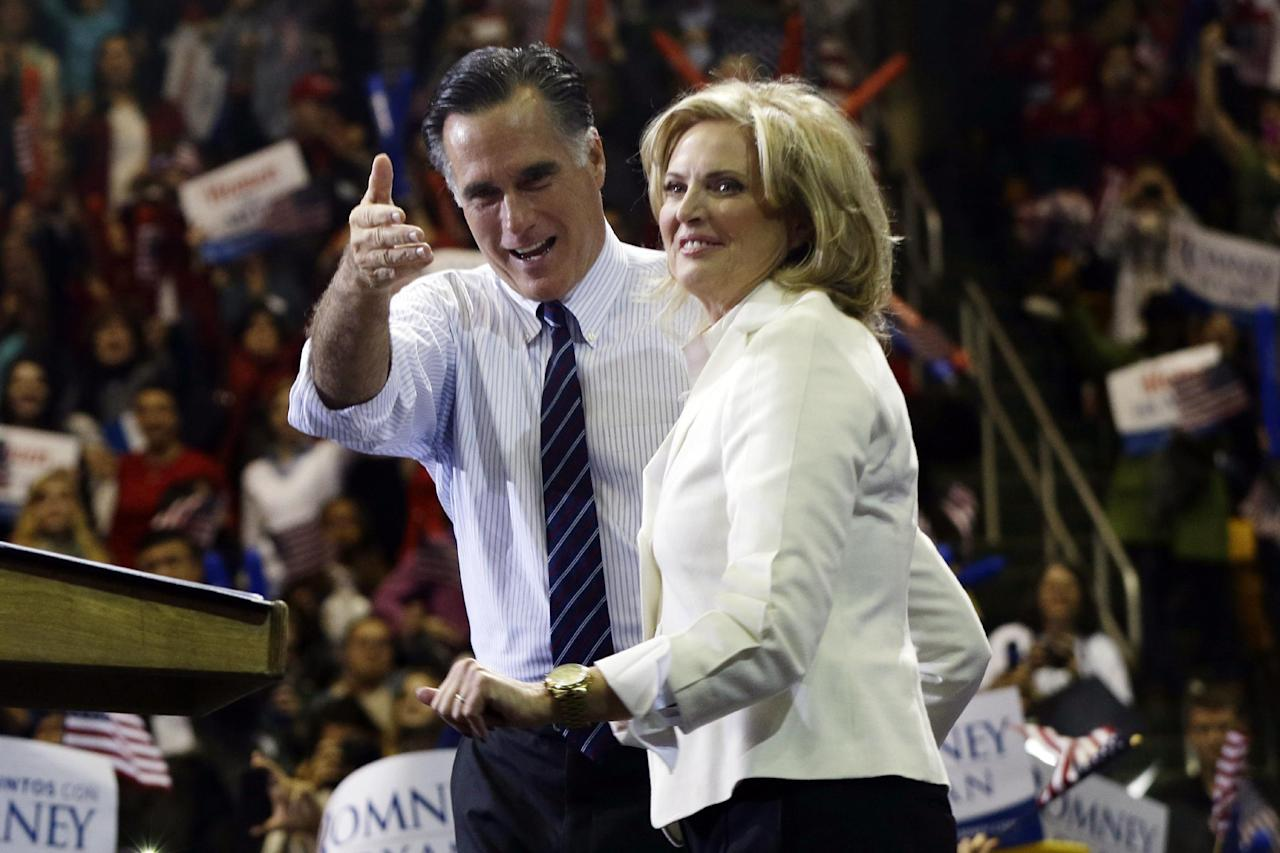 Republican presidential candidate and former Massachusetts Gov. Mitt Romney and wife Ann Romney stand on stage at a campaign rally at The Patriot Center at George Mason University in Fairfax, Va., Monday, Nov. 5, 2012. (AP Photo/Charles Dharapak)