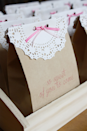 """<p>Send guests home with a sweet homemade treat. The adorable bags will get them excited before they even take a look inside.</p><p><strong>Get the tutorial at <a href=""""http://luluthebaker.com/2012/09/so-sweet-favor-bags/"""" rel=""""nofollow noopener"""" target=""""_blank"""" data-ylk=""""slk:Lulu the Baker"""" class=""""link rapid-noclick-resp"""">Lulu the Baker</a>.</strong></p>"""