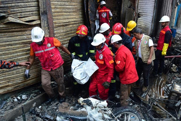 Firefighters have been searching for bodies in the charred buildings