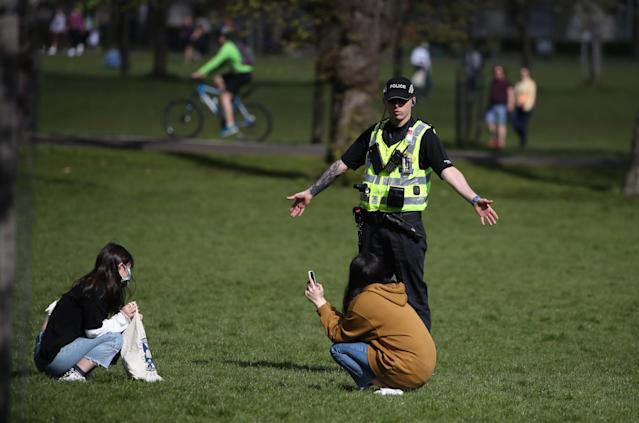 A police officer enforces lockdown restrictions in Edinburgh. (PA Images)