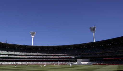 Spectators watch during play on day one of the Boxing Day cricket test between India and Australia at the Melbourne Cricket Ground, Melbourne, Australia, Saturday, Dec. 26, 2020. (AP Photo/Asanka Brendon Ratnayake)