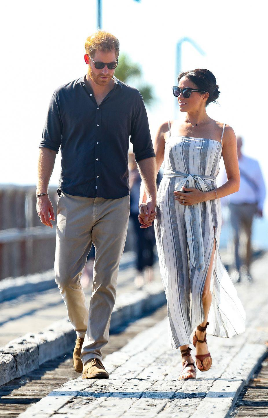<p>The palace prefers that the royals keep their wardrobes conservative, meaning the thigh-high slit that Meghan rocked while visiting Fraser Island in Australia may have caused some controversy.</p>