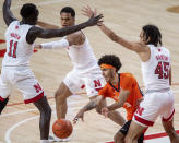 Illinois' Andre Curbelo (5) passes to a teammate as he's defended by Nebraska's Dalano Banton (45), Shamiel Stevenson (4) and Lat Mayen (11) during the first half of an NCAA college basketball game Friday, Feb. 12, 2021, in Lincoln, Neb. (Francis Gardler/Lincoln Journal Star via AP)