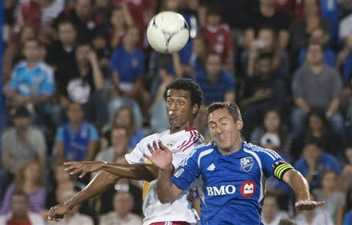 New York Red Bulls' Roy Miller, left, and Montreal Impact's David Arnaud jump for the header during the second half of an MLS soccer game Saturday, July 28, 2012, in Montreal. Montreal won 3-1. (AP Photo/The Canadian Press, Peter McCabe)