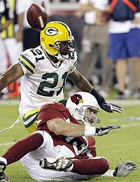 6c6624fb8 Woodson strips the Cards  Kurt Warner in the teams  preseason encounter.  (Ross D. Franklin AP Photo)