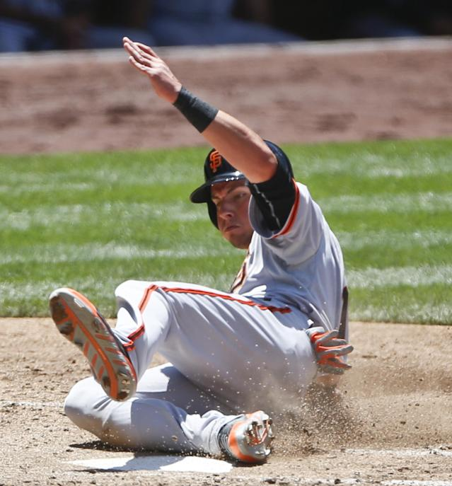 San Francisco Giants' Joe Panik slides in with th third Giants' run against the San Diego Padres in the third inning of a baseball game Sunday, July 6, 2014, in San Diego. (AP Photo/Lenny Ignelzi)