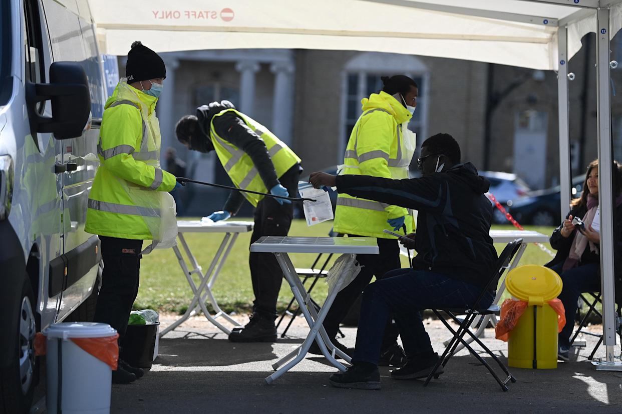People take Covid-19 tests at a mobile testing centre in south London. (Getty)