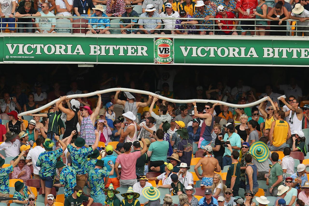 BRISBANE, AUSTRALIA - NOVEMBER 22:  Members of the crowd hold up a beer cup snake during day two of the First Ashes Test match between Australia and England at The Gabba on November 22, 2013 in Brisbane, Australia.  (Photo by Mark Kolbe/Getty Images)