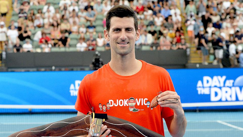 Pictured here, Novak Djokovic is presented with some Aussie souvenirs after his Adelaide exhibition match.