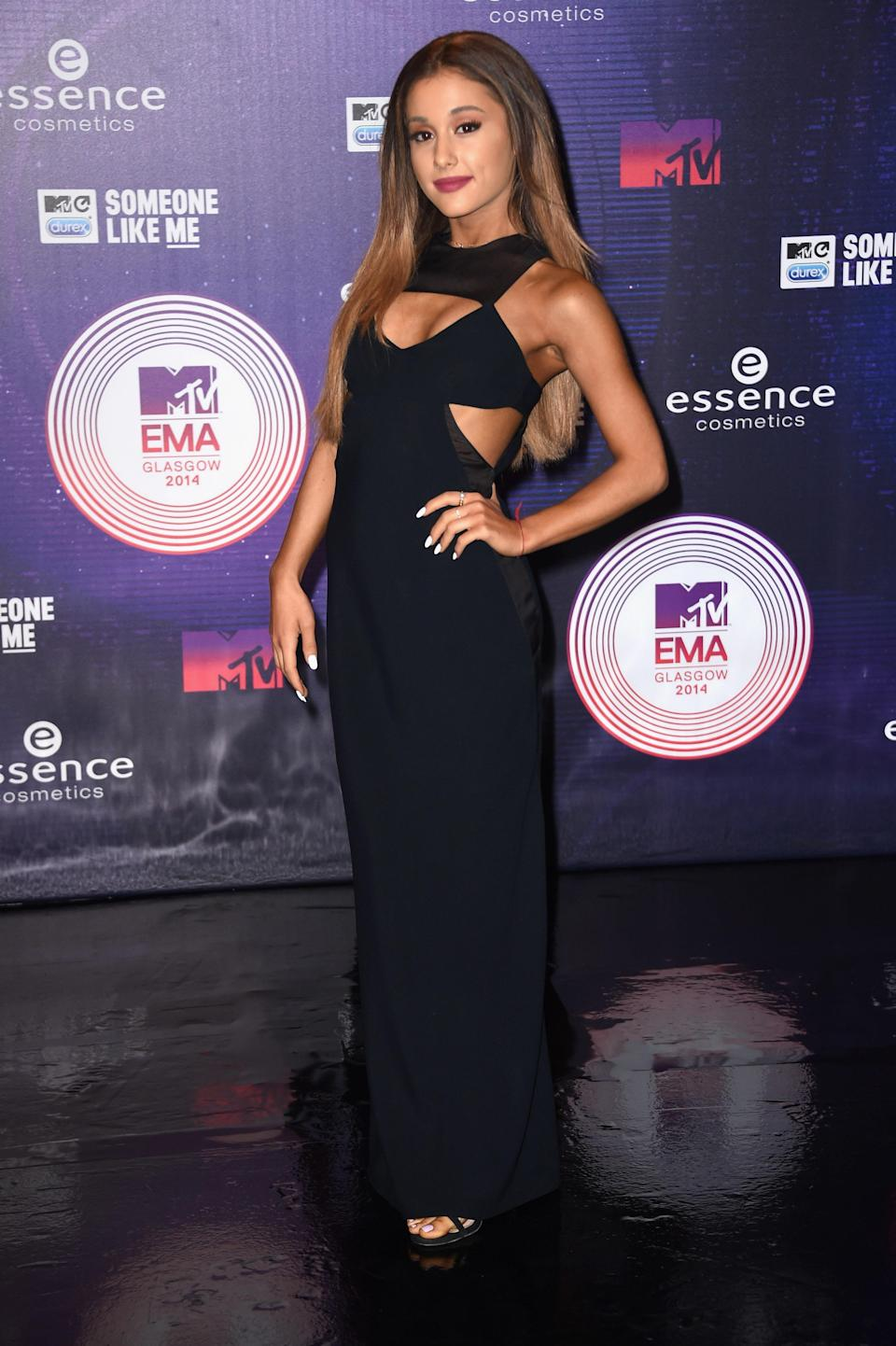 Over the years, Grande has embraced playing with different cuts and shapes that always hug her body in the right places. This black gown with geometric cutouts and mesh inserts she wore at the 2014 MTV EMA is no exception.