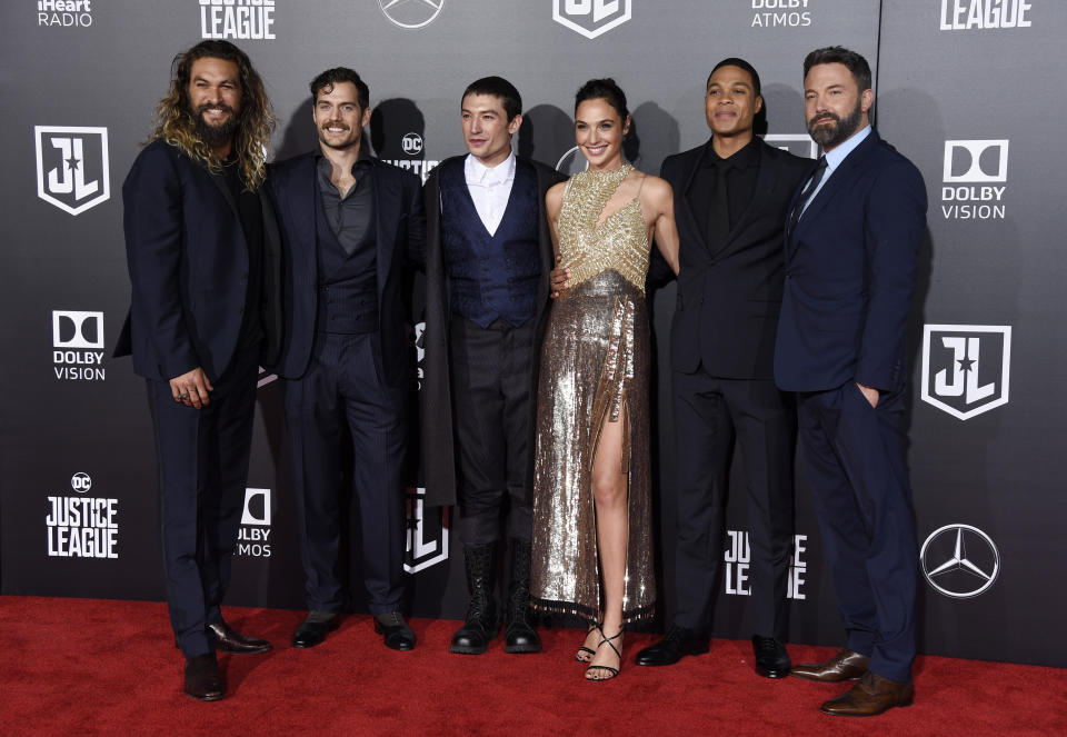 """FILE - The cast of """"Justice League,"""" from left, Jason Momoa, Henry Cavill, Ezra Miller, Gal Gadot, Ray Fisher and Ben Affleck, pose at the premiere of the film in Los Angeles. Warner Bros. Pictures say that director Zack Snyder's cut of the film"""" will debut next year on the streaming service HBO Max. (Photo by Chris Pizzello/Invision/AP, File)"""
