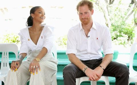 Rihanna and Prince Harry speak on stage at the 'Man Aware' event held by the Barbados National HIV/AIDS Commission in 2016 - Credit: Chris Jackson/Getty