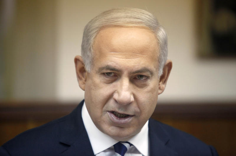 Israeli Prime Minister Benjamin Netanyahu attends the weekly cabinet meeting in his Jerusalem office, Sunday, Dec. 2, 2012. Israel has rejected the borders of a future Palestinian state the U.N. endorsed last week. And it is punishing the Palestinians further by withholding more than $100 million in taxes and other funds collected on their behalf. (AP Photo/Lior Mizrahi, Pool)