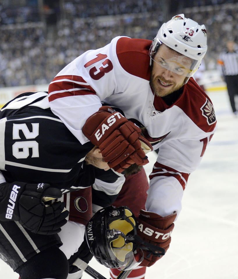 Phoenix Coyotes left wing Ray Whitney, right, tangles with Los Angeles Kings defenseman Slava Voynov, of Russia, during Game 4 of the NHL hockey Stanley Cup Western Conference finals, Sunday, May 20, 2012, in Los Angeles. (AP Photo/Mark J. Terrill)