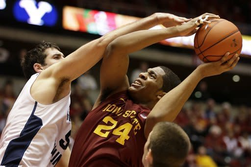 Iowa State center Percy Gibson (24) is fouled by Brigham Young forward Agustin Ambrosino, left, while shooting during the first half of an NCAA college basketball game, Saturday, Dec. 1, 2012, in Ames, Iowa. (AP Photo/Charlie Neibergall)