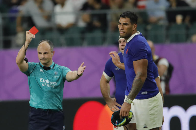 Referee Jaco Peyper shows a red card to France's Sebastien Vahaamahina during the Rugby World Cup quarterfinal match at Oita Stadium in Oita, Japan, Sunday, Oct. 20, 2019. (AP Photo/Christophe Ena)
