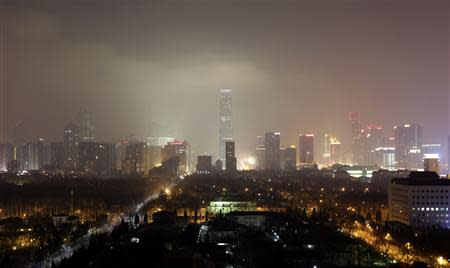 Buildings are pictured amid the heavy haze in Beijing's central business district