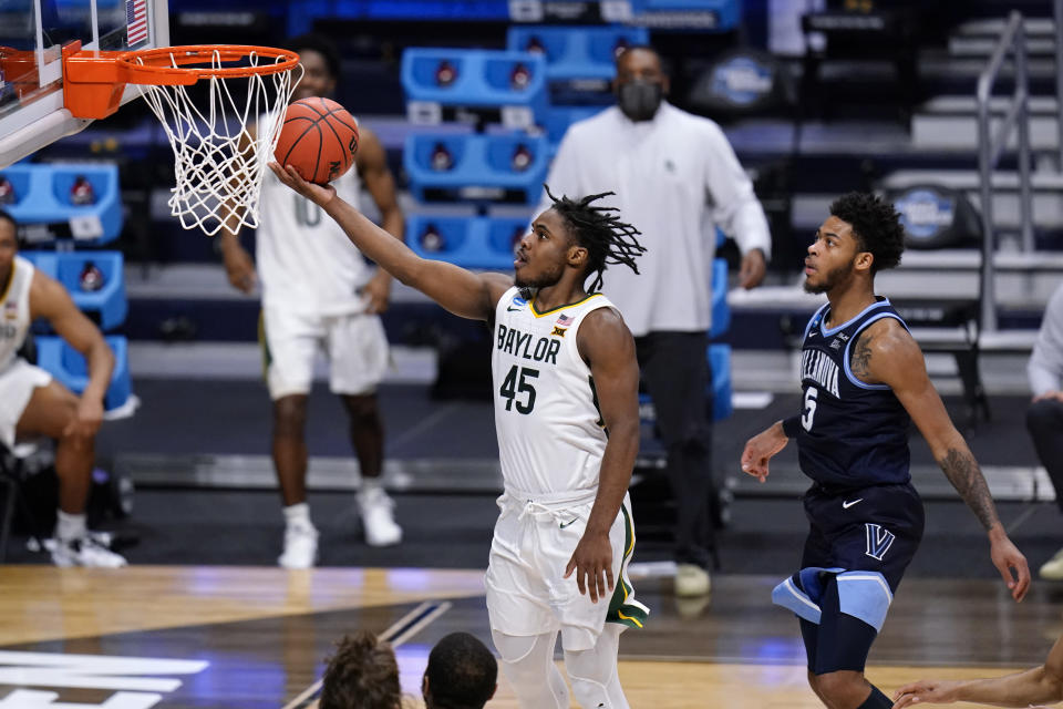 Baylor guard Davion Mitchell (45) drives past Villanova guard Justin Moore (5) in the second half of a Sweet 16 game in the NCAA men's college basketball tournament at Hinkle Fieldhouse in Indianapolis, Saturday, March 27, 2021. (AP Photo/AJ Mast)
