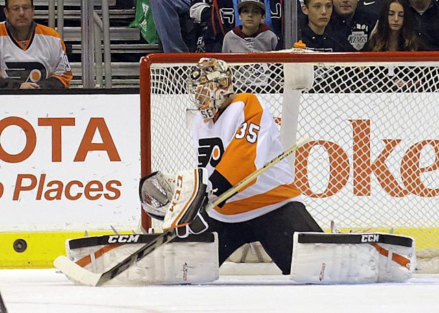 Philadelphia Flyers goalie Steve Mason (35) deflects a puck against the Los Angeles Kings in the first period of an NHL hockey game in Los Angeles Saturday, Feb. 1, 2014. (AP Photo/Reed Saxon)