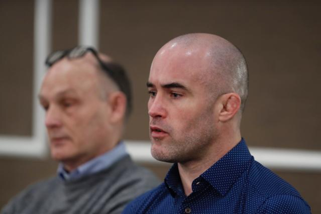 Andy Hrovat addresses the media during a news conference, Thursday, Feb. 27, 2020 in Southfield, Mich. Hrovat is one of the University of Michigan wrestlers who says he was abused by a sports doctor. (AP Photo/Carlos Osorio)