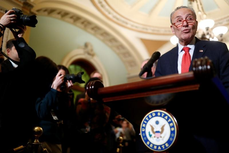 Senate Minority Leader Schumer speaks to Capitol Hill reporters following the weekly Senate Democratic policy lunch at the U.S. Capitol in Washington