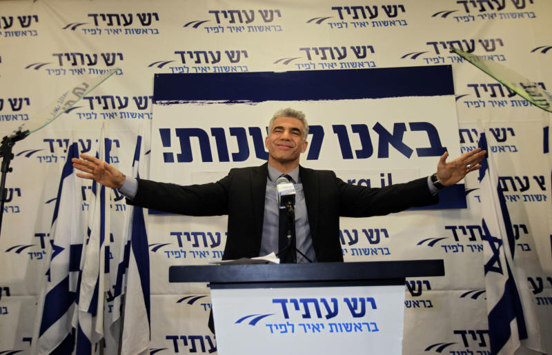 "File - In this Wednesday, Jan. 23, 2013 photo, Yair Lapid gestures as he delivers a speech at his ""Yesh Atid"" party in Tel-Aviv. Lapid, who leads the second-largest party in parliament with 19 seats, is set to serve as the new finance minister with great influence over the budget. His party will also control the Education Ministry. With these two ministries, he is likely to curb funding to ultra-Orthodox schools and institutions. (AP Photo/Sebastian Scheiner, FIle)"