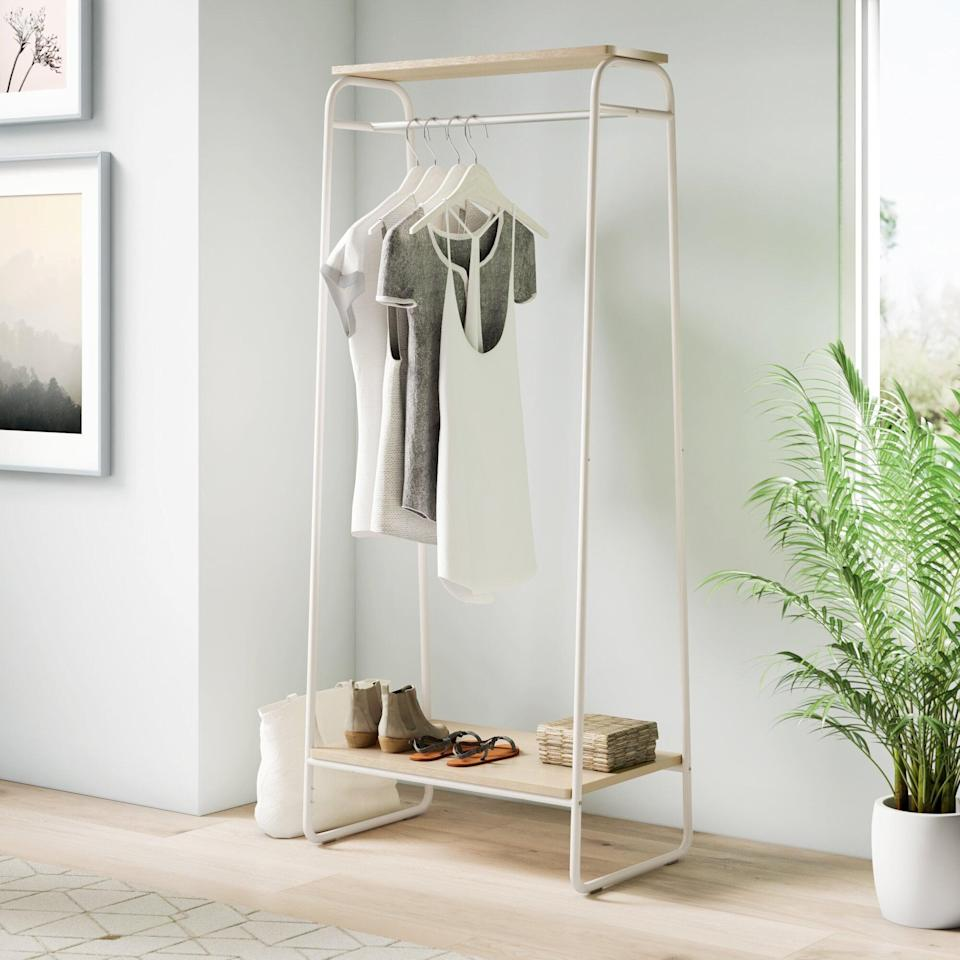 <p>This <span>Dotted Line Diggs Garment Rack</span> ($61) is a must if you're constantly transporting clothes.</p>