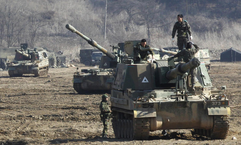 South Korean Army soldiers work on their K-9 self-propelled artillery vehicle during an exercise against possible attacks by North Korea near the border village of Panmunjom in Paju, South Korea, Monday, March 11, 2013. South Korea and the U.S. on Monday kicked off an annual military drill amid worries about a possible bloodshed following North Korea's threat to scrap a decades-old war armistice and launch a nuclear attack on the U.S. (AP Photo/Ahn Young-joon)
