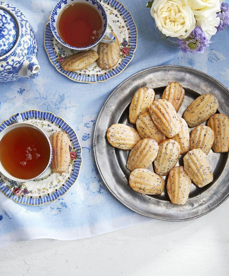 """<p>The perfect pair for a cup of tea, these dainty madeleines are great for munching in bed with a fresh pot of tea and a newspaper.</p><p><strong><a href=""""https://www.countryliving.com/food-drinks/a26592088/jasmine-madeleines-lemon-poppy-seed-glaze-recipe/"""" rel=""""nofollow noopener"""" target=""""_blank"""" data-ylk=""""slk:Get the recipe"""" class=""""link rapid-noclick-resp"""">Get the recipe</a>.</strong></p><p><strong><a class=""""link rapid-noclick-resp"""" href=""""https://www.amazon.com/Bellemain-12-Cup-Nonstick-Madeleine-Pan/dp/B00L5HCVSG?tag=syn-yahoo-20&ascsubtag=%5Bartid%7C10050.g.1681%5Bsrc%7Cyahoo-us"""" rel=""""nofollow noopener"""" target=""""_blank"""" data-ylk=""""slk:SHOP MADELEINE PANS"""">SHOP MADELEINE PANS</a><br></strong></p>"""