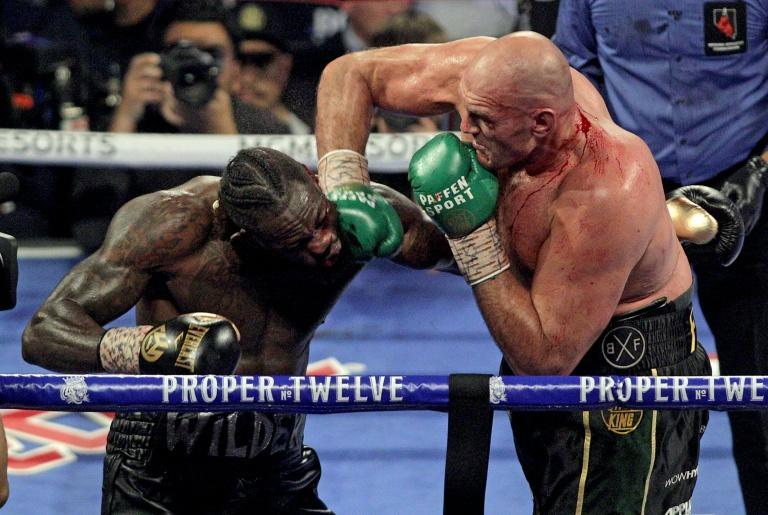 Tyson Fury (R) is looking forward to defeating Deontay Wilder (L) again when they meet for a third time